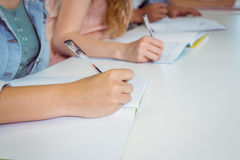 Students taking notes in class. At the college Royalty Free Stock Photo