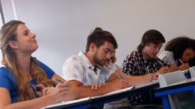 Students taking notes in class stock footage