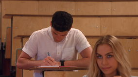 Students taking notes in lecture stock video footage