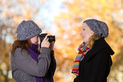 Students taking pictures outdoors fall Stock Images