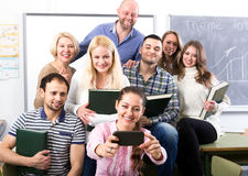 Students taking selfie in classroom stock photos