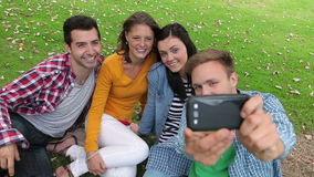 Students taking a selfie on the grass Stock Photos