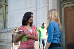 Students talking on campus. Diverse ethnic Students on university campus. A photo of Hispanic and Caucasian students royalty free stock photo