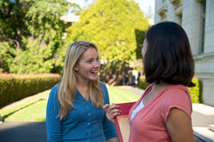 Students talking on Campus. Diverse ethnic Students on university campus. A photo of Hispanic and Caucasian students Royalty Free Stock Images