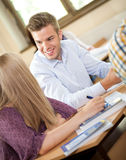 Students talking in class Royalty Free Stock Photo