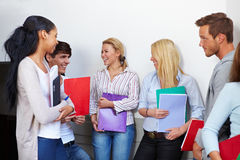 Students talking in the hall Royalty Free Stock Images