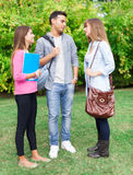 Students talking in a park Stock Photography
