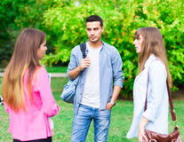 Students talking in a park Stock Photo