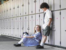 Students Talking By School Lockers Stock Photo