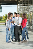 Students And Teacher With Book Standing On College Royalty Free Stock Photo