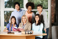 Students And Teacher With Books Smiling In Stock Images