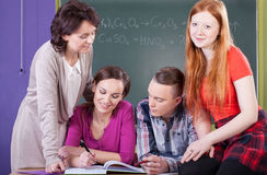 Students and teacher at chemistry lesson Royalty Free Stock Image