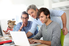Students with teacher in class Stock Photography