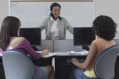 Students With Teacher In Classroom Royalty Free Stock Photo