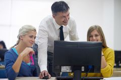 Students with teacher  in computer lab classrom Royalty Free Stock Photography