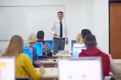 Students with teacher  in computer lab classrom Stock Image