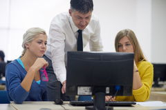 Students with teacher  in computer lab classrom Stock Images