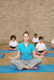 Students and teacher doing yoga pose. At the elementary school Royalty Free Stock Photos