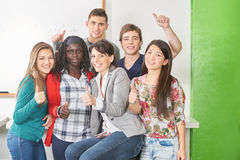 Students and teacher hold their thumbs up Stock Images