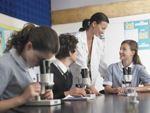 Students With Teacher In Laboratory Stock Photography