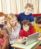 Students and teacher with laptop Royalty Free Stock Photo