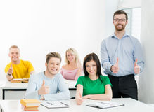 Students and the teacher learning in a classroom. Teacher and background not in focus Royalty Free Stock Image