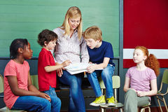 Students and teacher learning. Together in elementary school class stock images