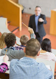 Students with teacher at lecture hall Stock Images