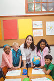 Students and teacher looking at the camera Royalty Free Stock Photography