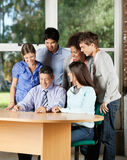 Students And Teacher Looking At Digital Tablet In Royalty Free Stock Images