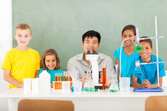 Students teacher science. Group elementary school students and teacher in a science class royalty free stock photography