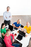 Students with teacher studying using modern technologies Stock Image