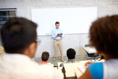 Students and teacher with tablet pc at lecture Royalty Free Stock Image