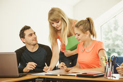 Students and teacher tutor in classroom Royalty Free Stock Photo