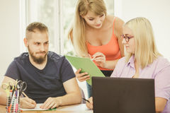 Students and teacher tutor in classroom Stock Photography