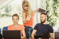 Students and teacher tutor in classroom Royalty Free Stock Images