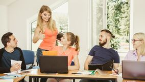 Students and teacher tutor in classroom Stock Images