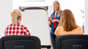 Students and teacher tutor in classroom Stock Photo
