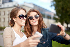 Students or teenage girls with smarphone Royalty Free Stock Photography