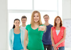 Students with teenager in front pointing at you Stock Photography