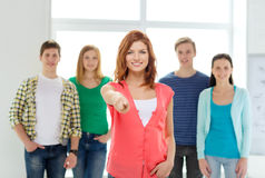 Students with teenager in front pointing at you Stock Photos
