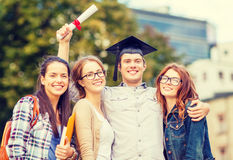 Students or teenagers with files and diploma. Education, campus and teenage concept - group of students or teenagers with files, folders, eyeglasses and diploma Stock Photography