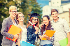 Students or teenagers with files and diploma Royalty Free Stock Photos