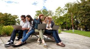 Students or teenagers with laptop computers Stock Photography