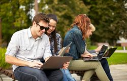 Students or teenagers with laptop computers Stock Image