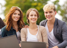 Students or teenagers with laptop computers Stock Photo