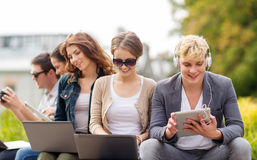 Students or teenagers with laptop computers Stock Images