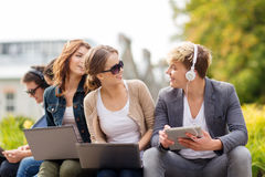Students or teenagers with laptop computers Royalty Free Stock Image