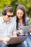 Students or teenagers with laptop computers Royalty Free Stock Images