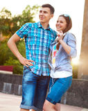 Students or teenagers outdoors in summer evening Royalty Free Stock Photography